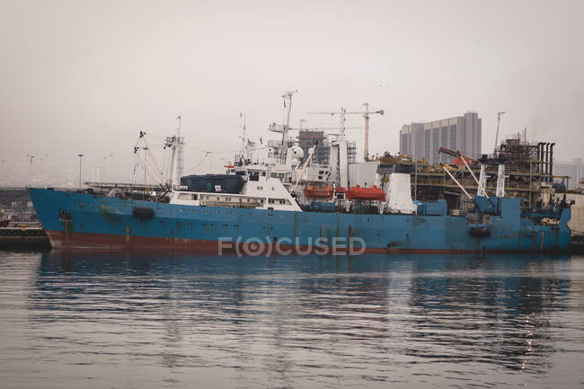Cargo ships moored in the dockyards at dusk — Stock Photo
