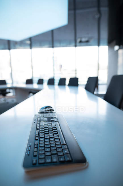 Close-up of keyboard on table in office. — Stock Photo