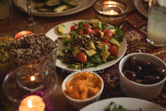 Closeup view of variety of food served on table — Stock Photo