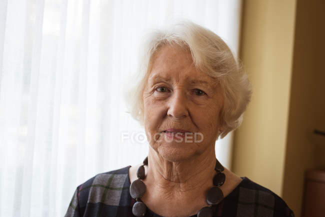 Close-up of senior woman looking at camera — Stock Photo