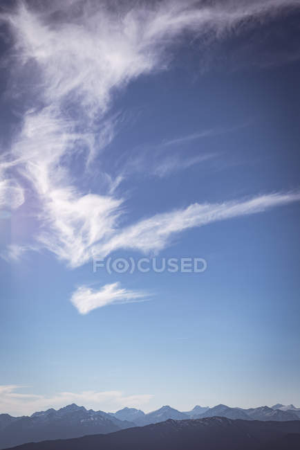 Clouds passing over a mountain range at daytime — Stock Photo