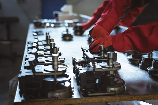 Two workers checking machine parts in factory — Stock Photo