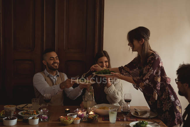 Group of friends having meal at table — Stock Photo