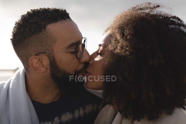 Close-up of romantic couple kissing each other — Stock Photo