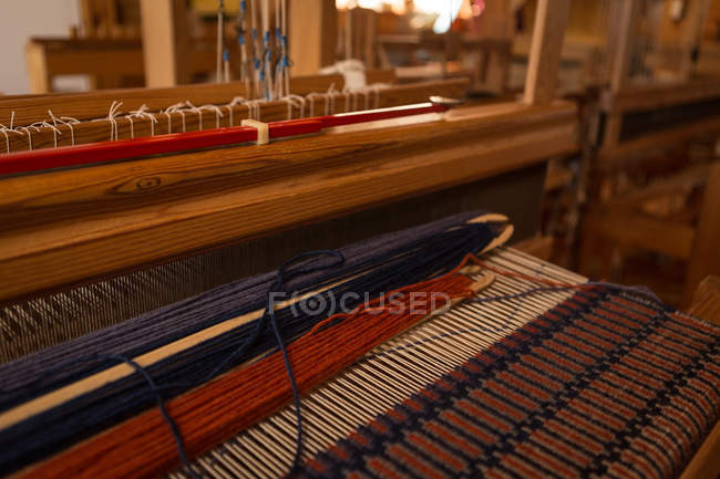 Close-up of machine with silk thread in factory — Stock Photo