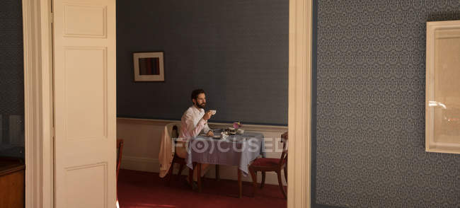 Caucasian young groom having tea at home — Stock Photo