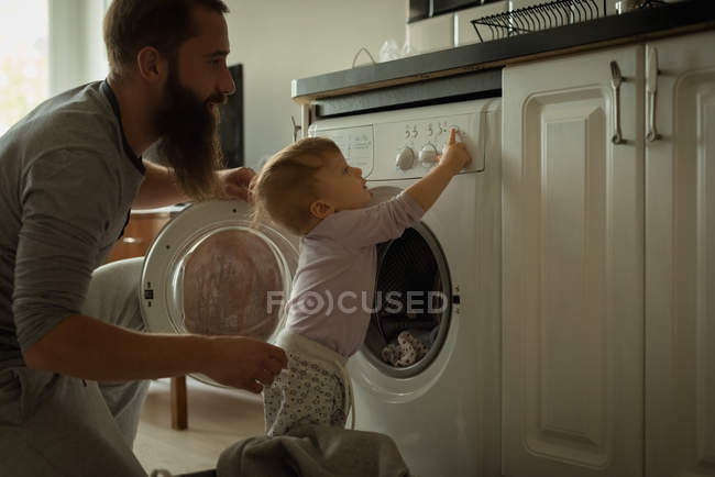 Father playing with his son at home — Stock Photo