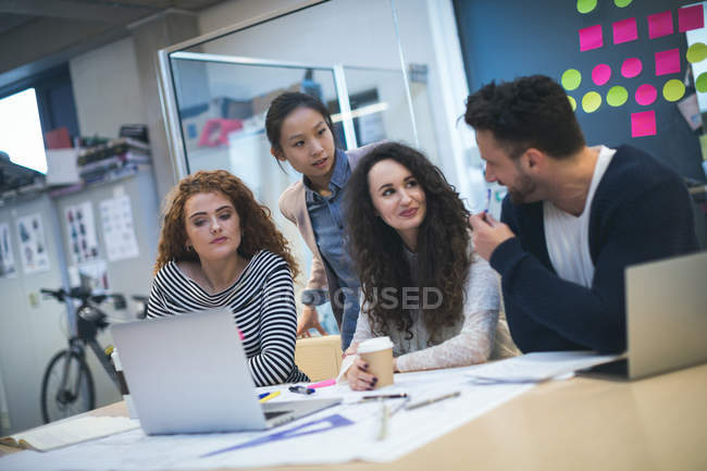 Executives discussing with each other in modern office — Stock Photo