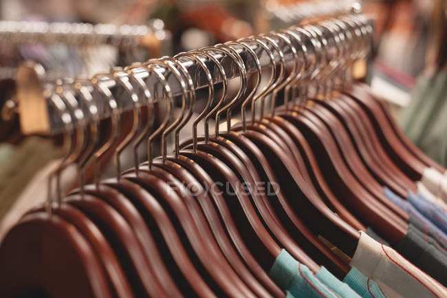 Close-up of clothes hanger arranged on rack — Stock Photo