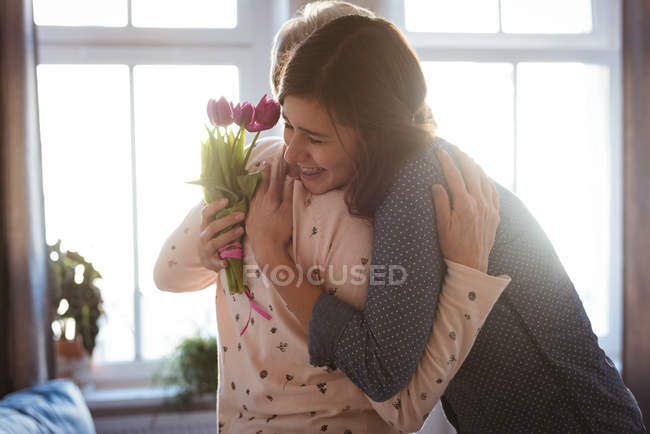 Senior woman and daughter hugging each other at daytime — Stock Photo