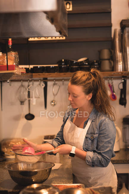 Baker baking in commercial kitchen — Stock Photo