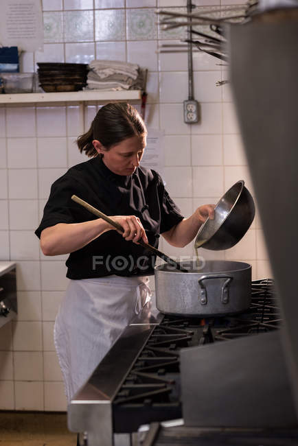 Determined chef cooking in the commercial kitchen — Stock Photo