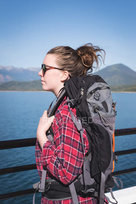 Thoughtful female hiker looking at view on a sunny day — Stock Photo
