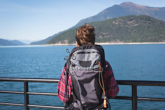 Rear view of female hiker looking at view on a sunny day — Stock Photo