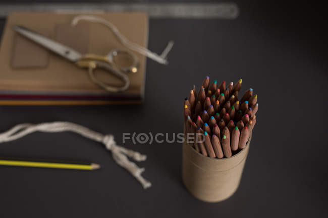 Close-up of colorful pencils in holder at table — Stock Photo