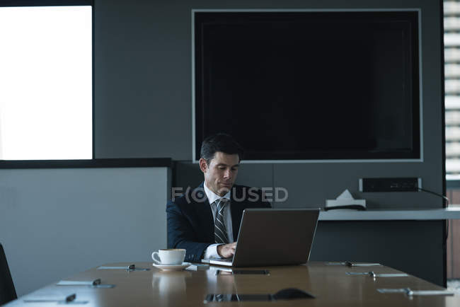 Business man using laptop in conference room — Stock Photo