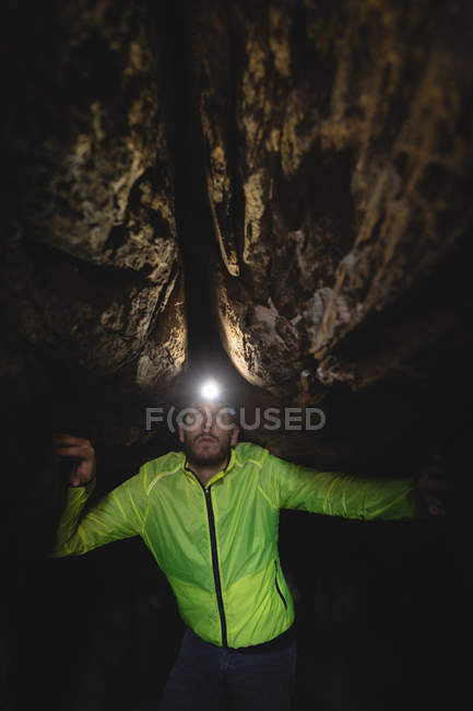 Close-up of hiker exploring the dark cave — Stock Photo