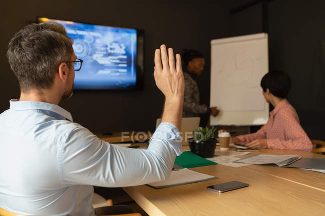 Executive asking while discussing on whiteboard in office. — Stock Photo