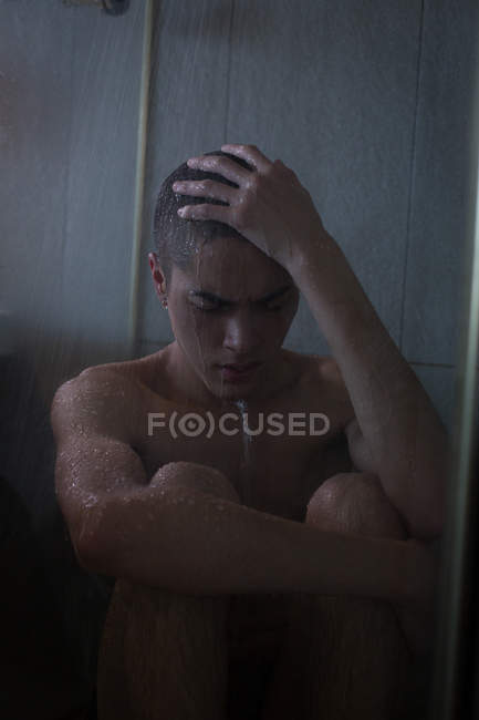 Young man bathing in bathroom at home — Stock Photo