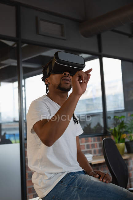 Excited man experiencing virtual reality in office. — Stock Photo