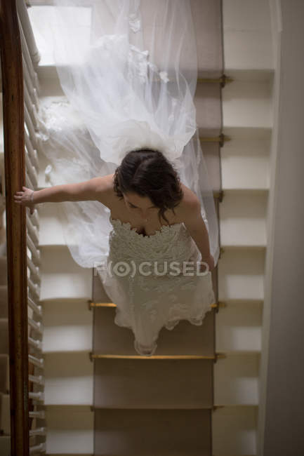 High angle view of bride walking down the steps at home — Stock Photo