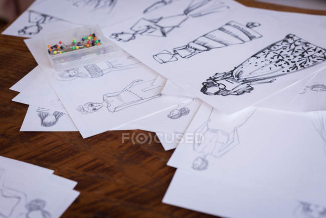 Close-up of sketches of design on table in studio. — Stock Photo