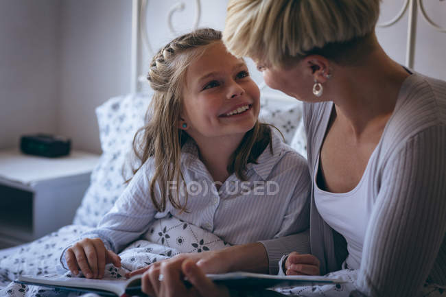 Grandmother and granddaughter interacting with each other at home — Stock Photo
