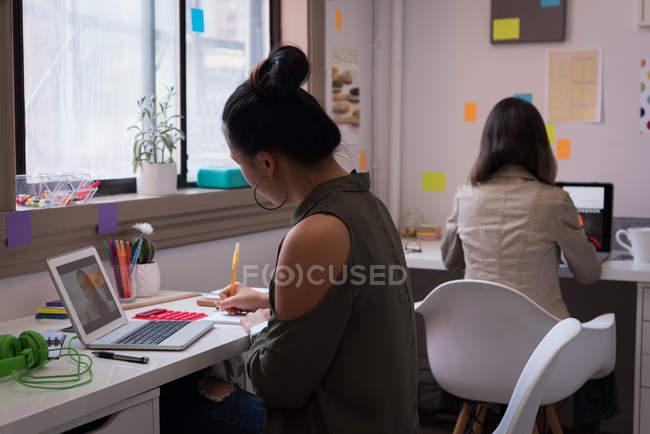 Two Fashion Designers Working On Laptops In Design Studio Female Browsing Stock Photo 209284506