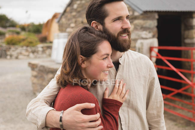 Affectionate couple embracing each other at countryside — Stock Photo