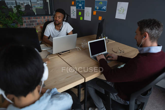 Attentive colleagues working at desk in modern office. — Stock Photo