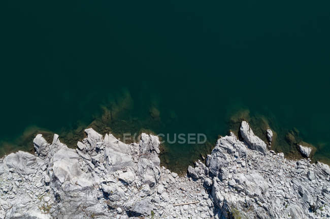 Overhead view of rocky coast along the turquoise sea — Stock Photo
