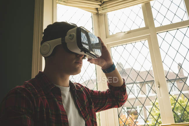 Close-up of man using virtual reality headset in living room. — Stock Photo
