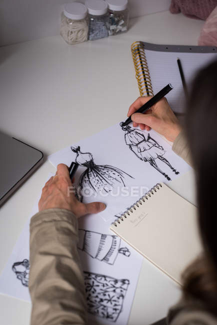 High angle view of fashion designer making sketches in design studio. — Stock Photo