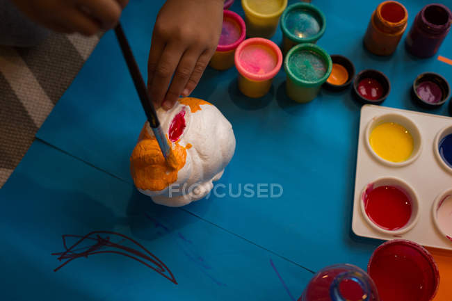 Close-up of girl painting a toy — Stock Photo