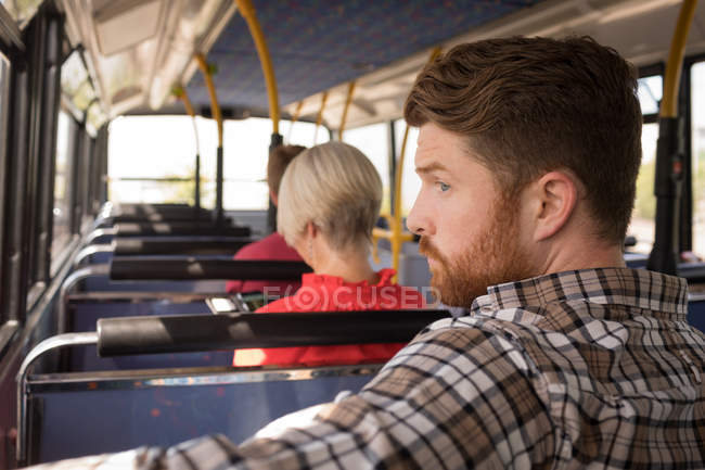 Smart male commuter travelling in modern bus — Stock Photo