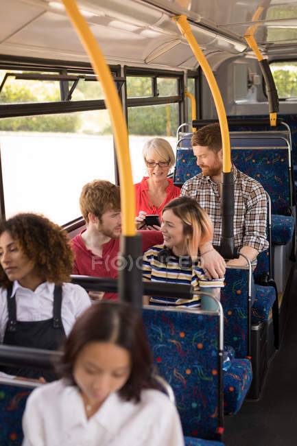 Commuter travelling in modern bus — Stock Photo