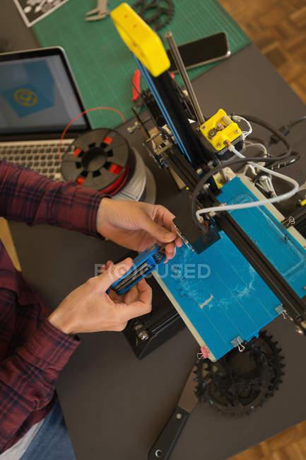 Overhead of mechanic adjusting die machine in workshop — Stock Photo