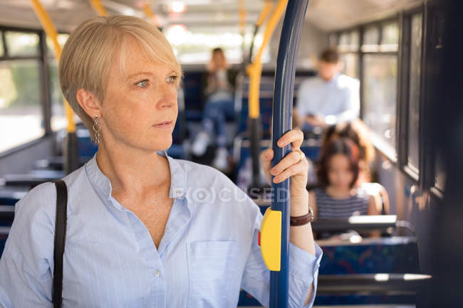 Female commuter travelling in modern bus — Stock Photo