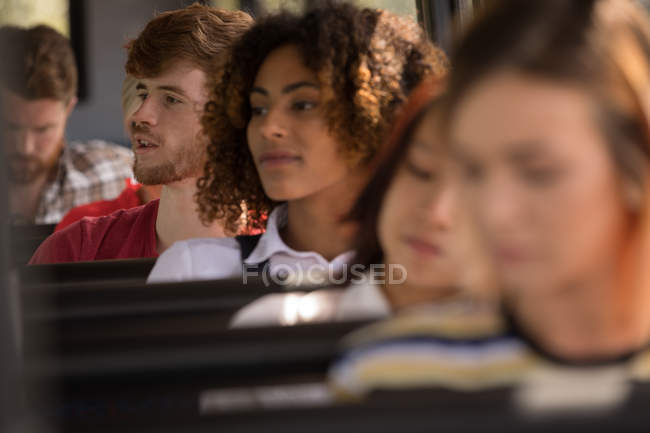 Commuters travelling in modern bus — Stock Photo