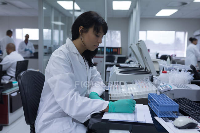 Attentive laboratory technician working in blood bank — Stock Photo