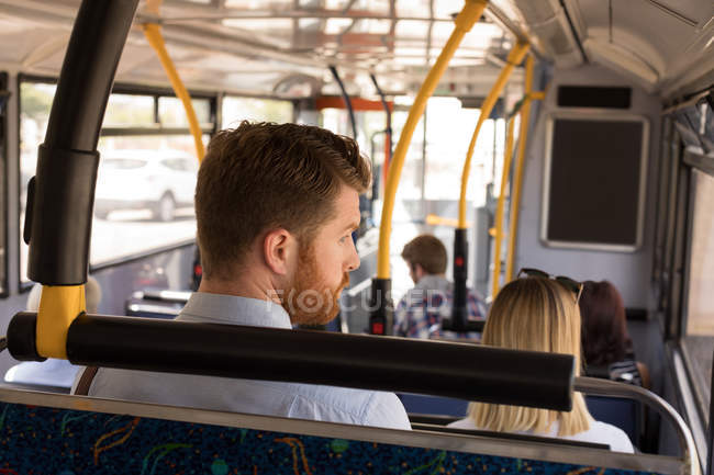 Smart man travelling in modern bus — Stock Photo