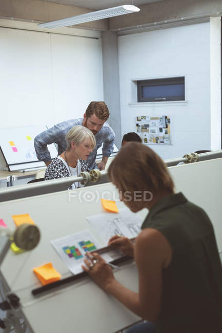 Executives discussing with each other in office — Stock Photo