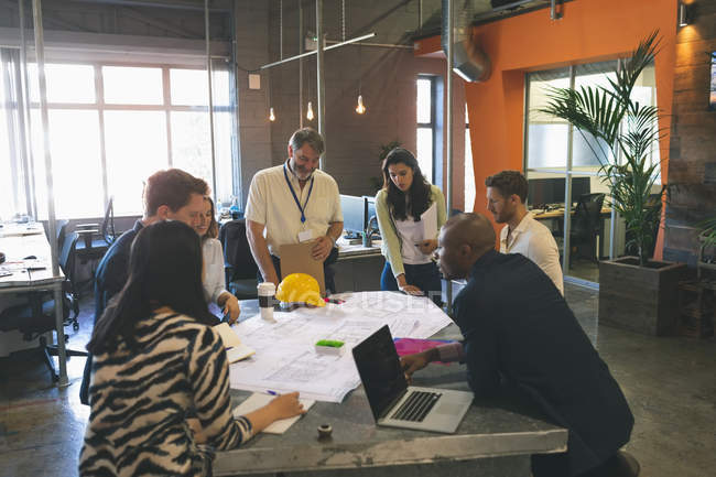 Business people discussing over blueprint in the meeting at office — Stock Photo