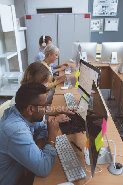 Attentive executives working at desk in office — Stock Photo