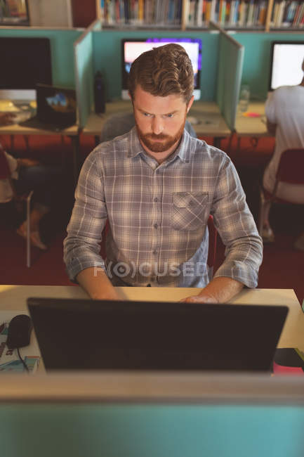 Attentive male executive working at desk in office — Stock Photo