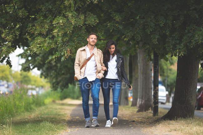 Romantic couple walking on street in the city — Stock Photo