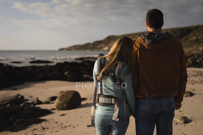Rear view of couple walking on beach — Stock Photo