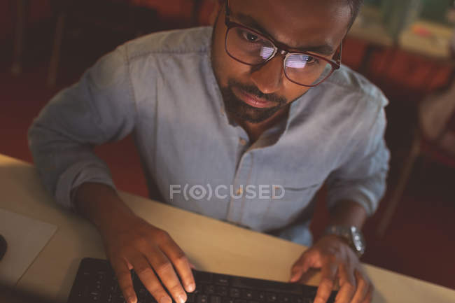 Close-up of male executive working at desk in office — Stock Photo