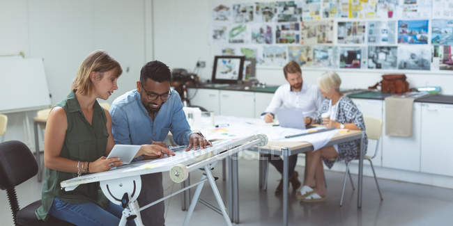Attentive executives working in office — Stock Photo