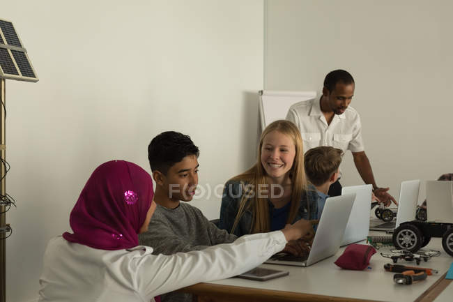 Students discussing over the laptop in training institute — Stock Photo
